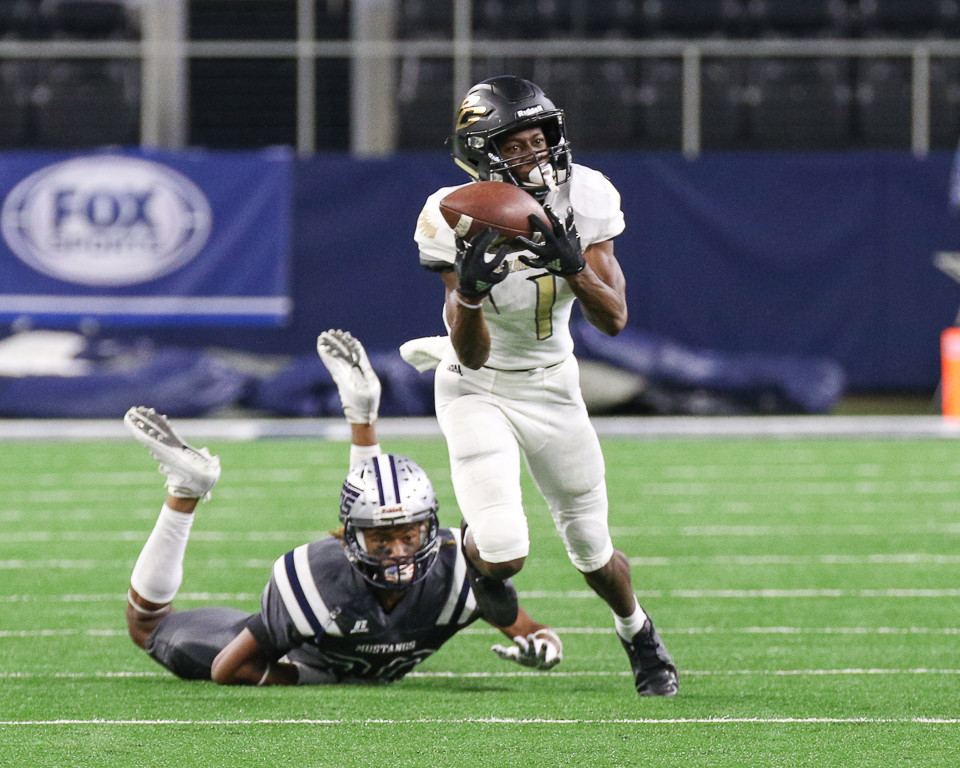 Pleasant Grove Hawks senior defensive back Cameron Wells (1) intercepts a pass during the second quarter of the UIL Class 4A Division II state football championship game between West Orange-Stark High School and Pleasant Grove High School at AT&T Stadium in Arlington, Texas, on December 22, 2017.