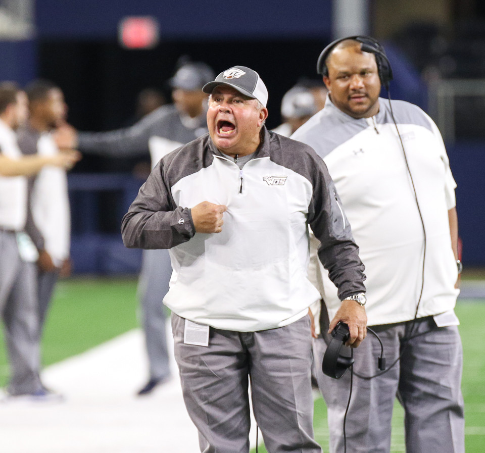 West Orange-Stark Mustangs head coach Cornel Thompson expresses his displeasure with an offensive penalty during the second quarter of the UIL Class 4A Division II state football championship game between West Orange-Stark High School and Pleasant Grove High School at AT&T Stadium in Arlington, Texas, on December 22, 2017.