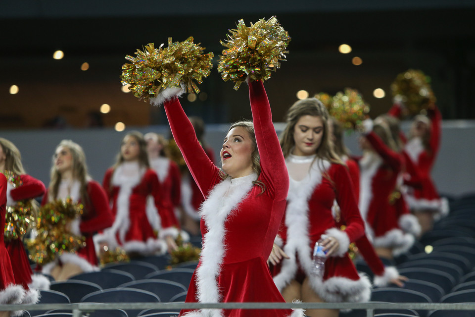 The Pleasant Grove Hawks cheerleaders during the UIL Class 4A Division II state football championship game between West Orange-Stark High School and Pleasant Grove High School at AT&T Stadium in Arlington, Texas, on December 22, 2017.