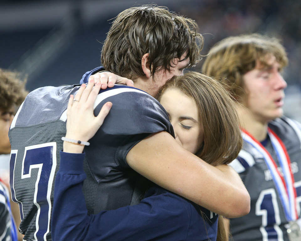 West Orange-Stark Mustangs senior Kaleb Ramsey (17) shares a moment with his girlfriend on the field after a 41-21 loss to Pleasant Grove in the UIL Class 4A Division II state football championship game at AT&T Stadium in Arlington, Texas, on December 22, 2017.