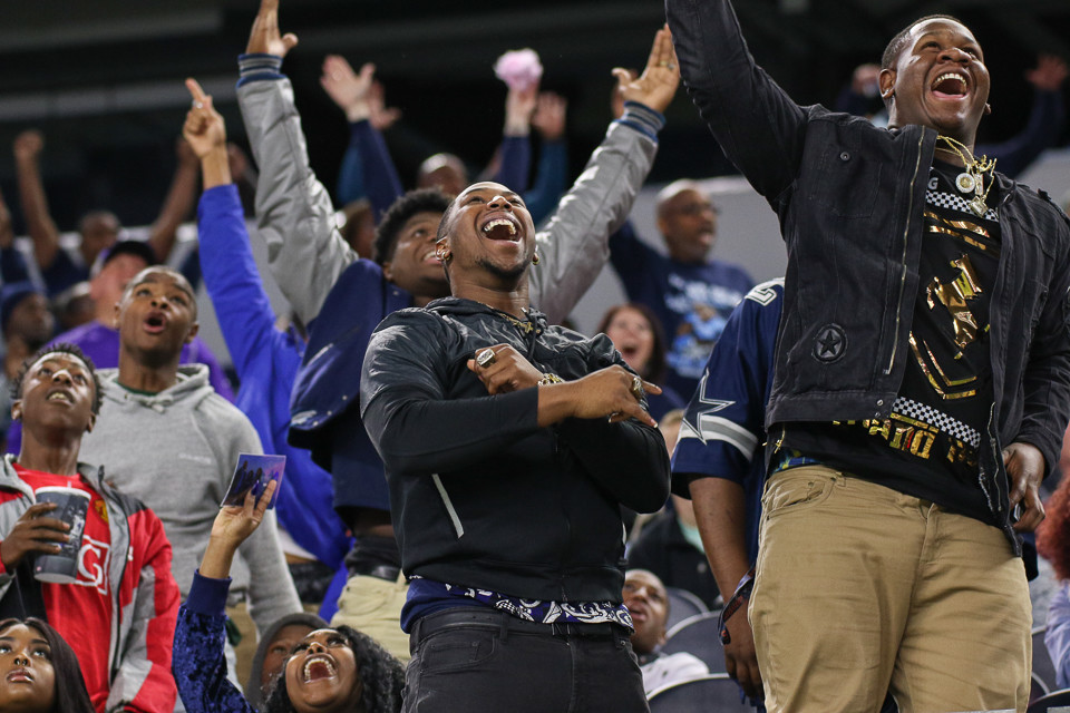 West Orange-Stark Mustangs fans react to a touchdown in the first half of the UIL Class 4A Division II state football championship game between West Orange-Stark High School and Pleasant Grove High School at AT&T Stadium in Arlington, Texas, on December 22, 2017.