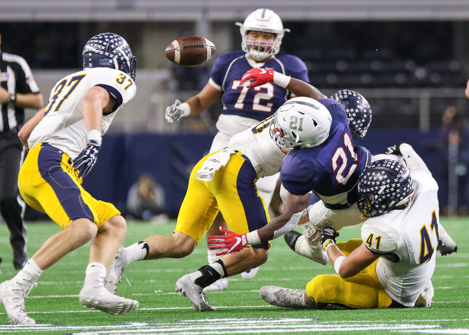 Manvel Mavericks junior running back Ladarius Owens (21) fumbles on a running play during the UIL Class 5A Division I state football championship game between Manvel High School and Highland Park High School at AT&T Stadium in Arlington, Texas, on December 22, 2017.
