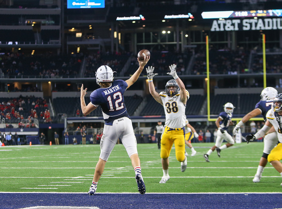 Manvel Mavericks senior quarterback Kason Martin (12) throws a record-setting 95-yard touchdown pass during the fourth quarter of the UIL Class 5A Division I state football championship game between Manvel High School and Highland Park High School at AT&T Stadium in Arlington, Texas, on December 22, 2017.