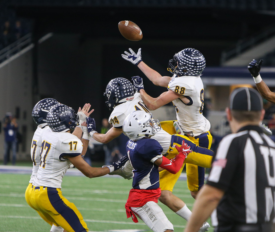 Highland Park Scots senior wide receiver Cade Saustad (88) brings in an onside kick that allowed his team to win the UIL Class 5A Division I state football championship game between Manvel High School and Highland Park High School at AT&T Stadium in Arlington, Texas, on December 22, 2017.