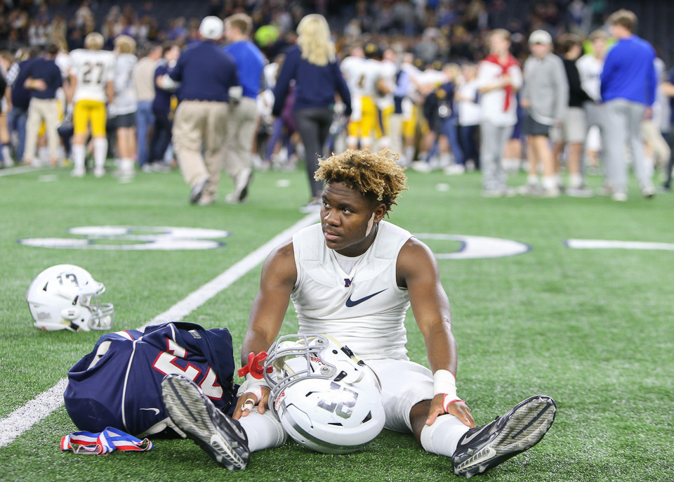 Manvel Mavericks junior defensive back Trevion Robertson (27) takes a moment to reflect on the field after his team lost the UIL Class 5A Division I state football championship game 53-49 to Highland Park High School at AT&T Stadium in Arlington, Texas, on December 22, 2017.
