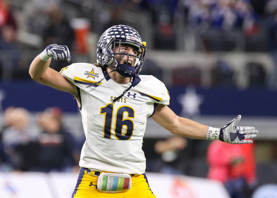 Highland Park Scots junior defensive back Jed Clouse (16)  celebrates after a touchdown during the UIL Class 5A Division I state football championship game between Manvel High School and Highland Park High School at AT&T Stadium in Arlington, Texas, on December 22, 2017.