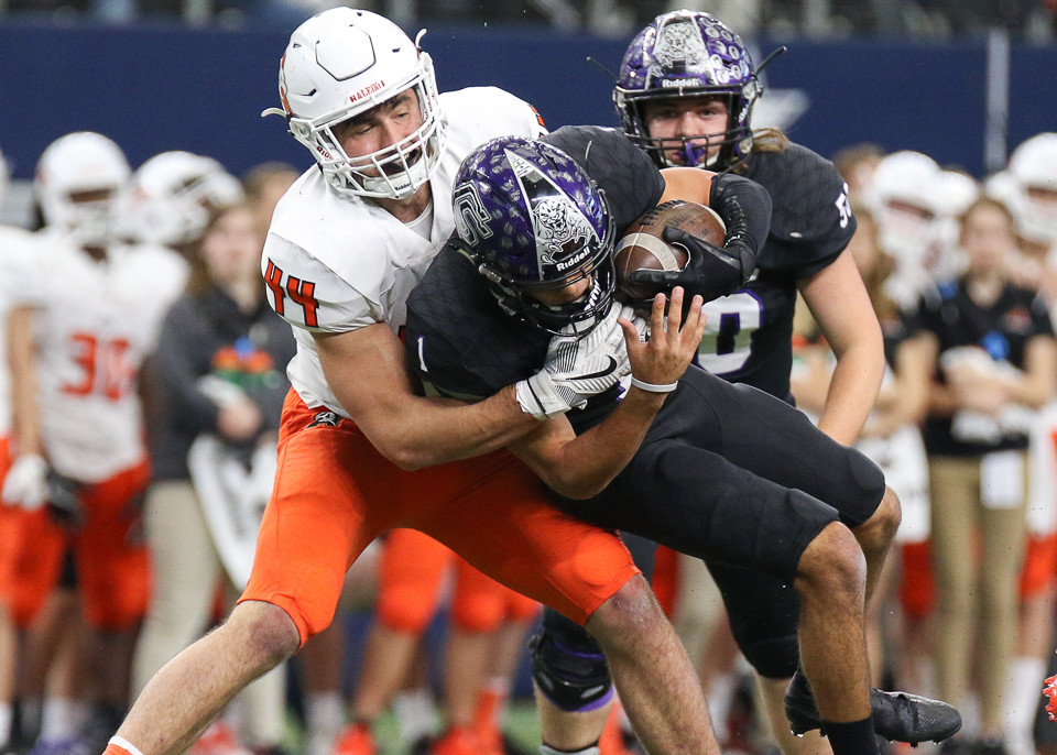 College Station Cougars senior quarterback Marquez Perez (1) is sacked by Aledo Bearcats junior defensive lineman Colt Ellison (44) during the UIL Class 5A Division II state football championship game between College Station High School and Aledo High School at AT&T Stadium in Arlington, Texas, on December 23, 2017.