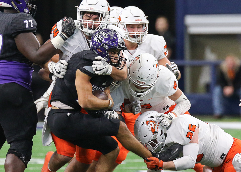 College Station Cougars senior quarterback Marquez Perez (1) is sacked by a group of Aledo Bearcats defenders during the UIL Class 5A Division II state football championship game between College Station High School and Aledo High School at AT&T Stadium in Arlington, Texas, on December 23, 2017.
