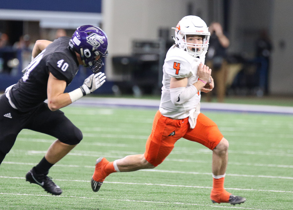 College Station Cougars senior linebacker Chris Williams (40) pursues Aledo Bearcats sophomore quarterback Jake Bishop (4) in the backfield during the first half of the UIL Class 5A Division II state football championship game between College Station High School and Aledo High School at AT&T Stadium in Arlington, Texas, on December 23, 2017.