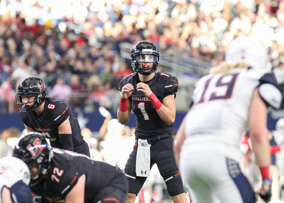 Lake Travis Cavaliers quarterback Hudson Card (1) prepares to take a snap during the UIL Class 6A Division I state football championship game between Lake Travis High School and Allen High School at AT&T Stadium in Arlington, Texas, on December 23, 2017.