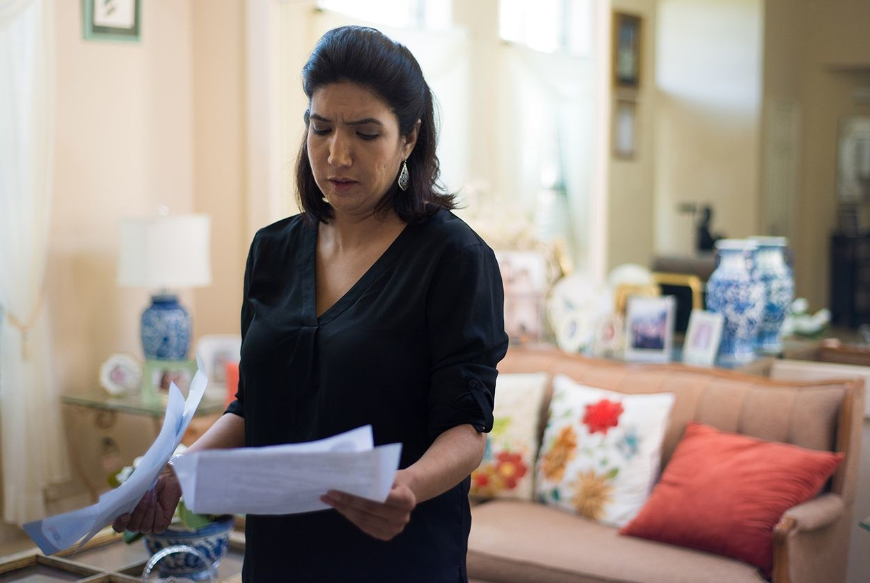 A rent-to-company threatened to file criminal charges against Austin resident Melinda Sandlin after she stopped making payments. Sandlin looks through her rental purchase agreement and other related documents at her Austin home on August 30, 2017.