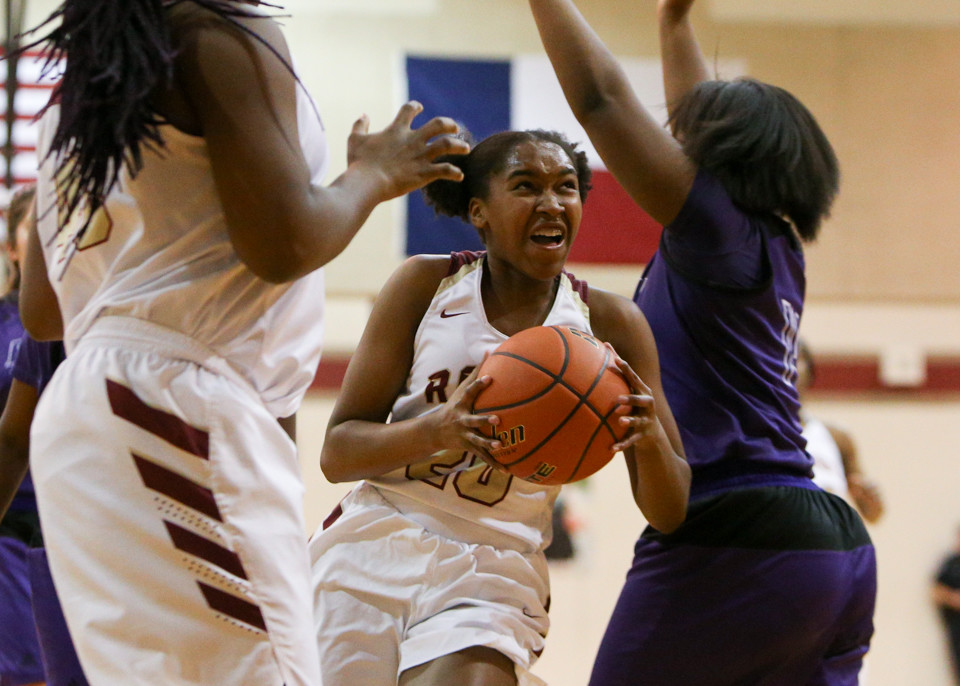 Rouse senior guard Zaiah Jackson (20) weaves through defenders during Rouse's 52-28 win over Elgin on Tuesday.