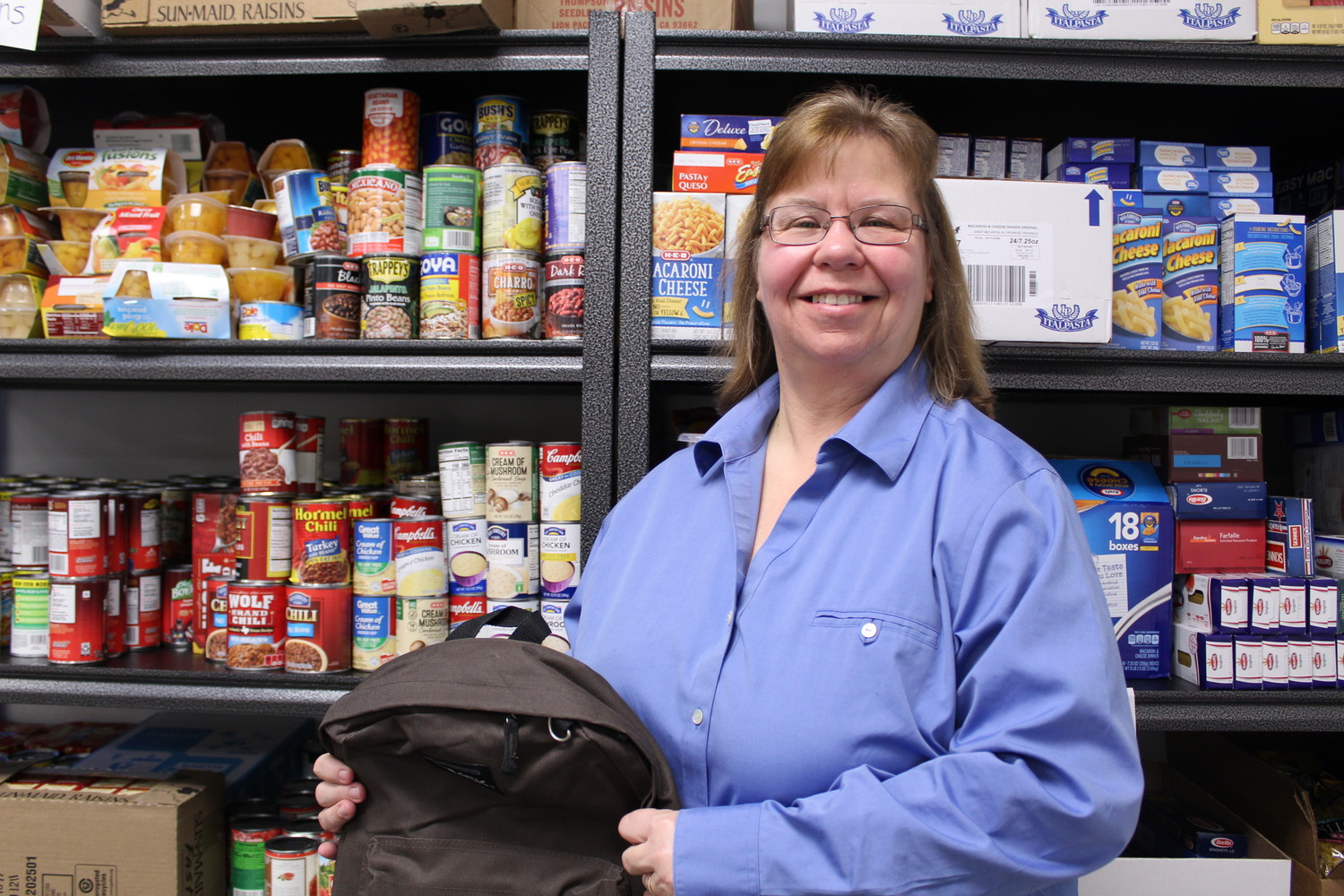 Karen Faulkner, president of Student Charities, works to ensure Leander ISD students don't go home hungry. For children that rely on being able to eat breakfast and lunch at school, the extended break often means missing meals. Student Charities' backpack and winter food box programs provide meals for the two weeks of holidays for families.