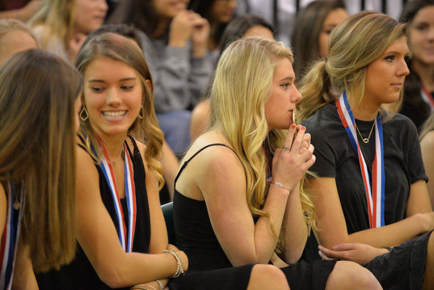 Cheerleaders watch as the CPHS Dance Team performs during their school pep rally, Tuesday, Jan. 23.