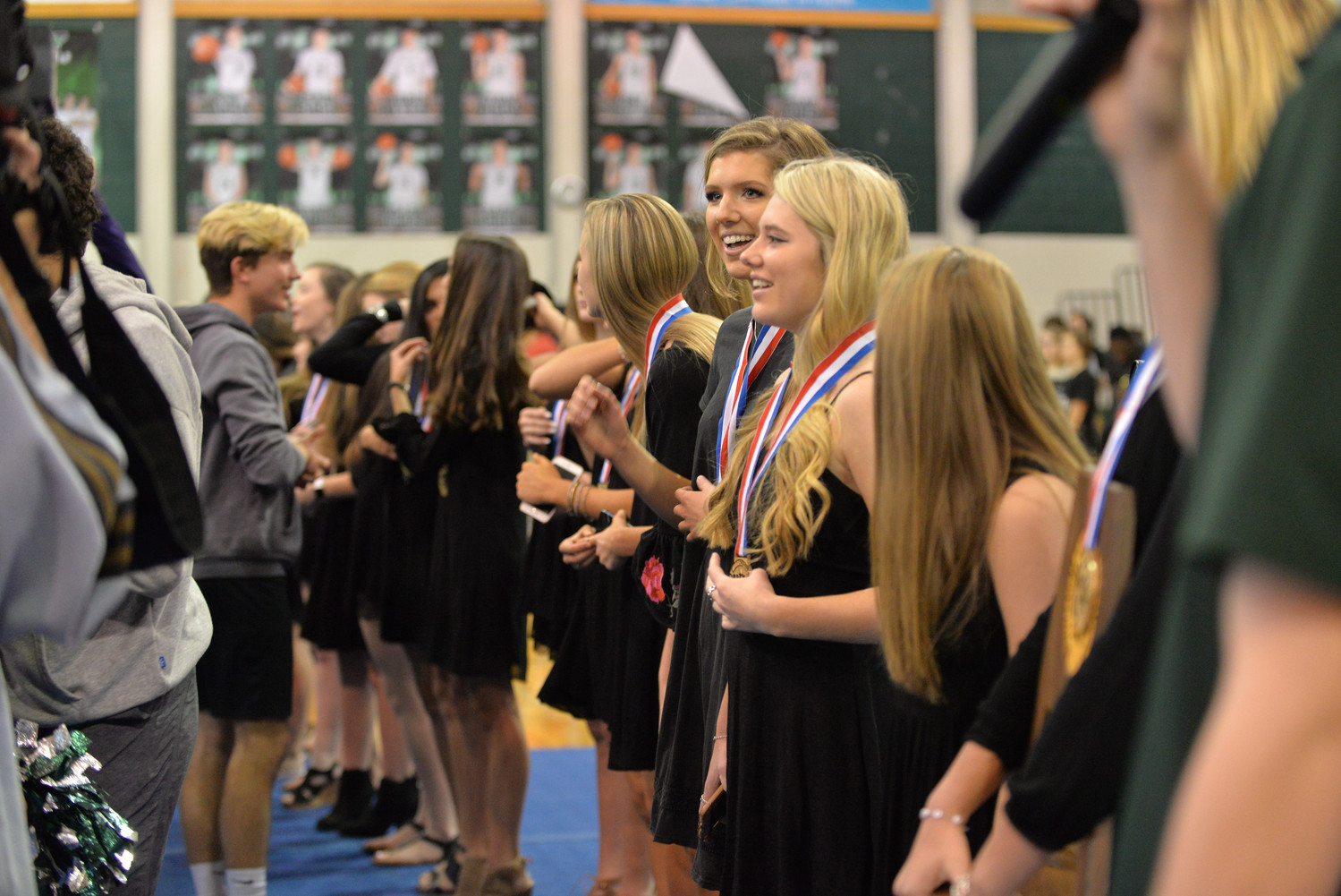 CPHS athletes presented the cheerleaders with their UIL medals at their pep rally celebrating their state title.