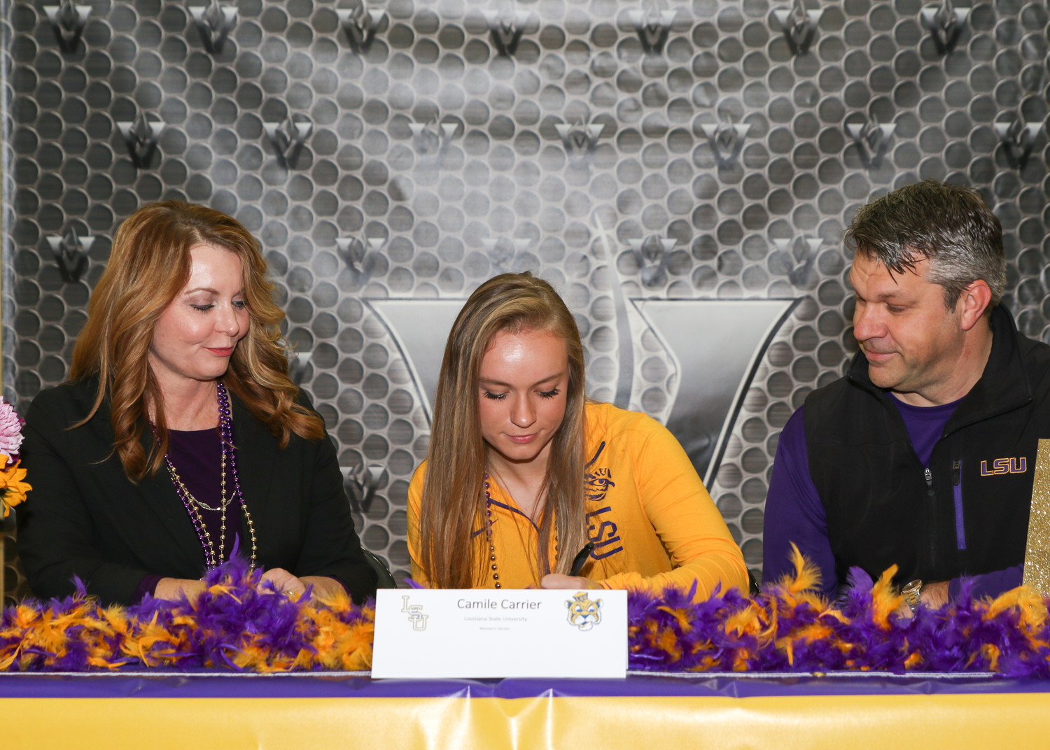 Camile Carrier signed a letter of intent to play soccer at Louisiana State University during a signing day ceremony at Vandegrift High School on February 7, 2018.
