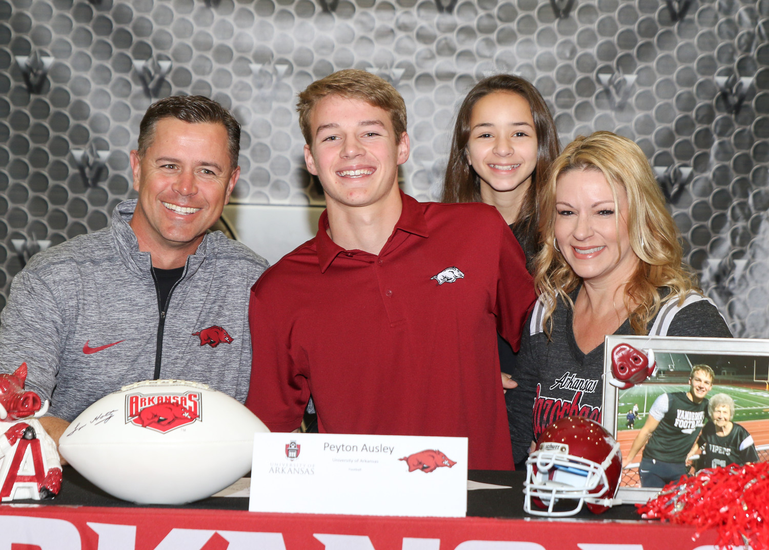 Peyton Ausley signed a letter of intent to play football at the University of Arkansas during a signing day ceremony at Vandegrift High School on February 7, 2018.