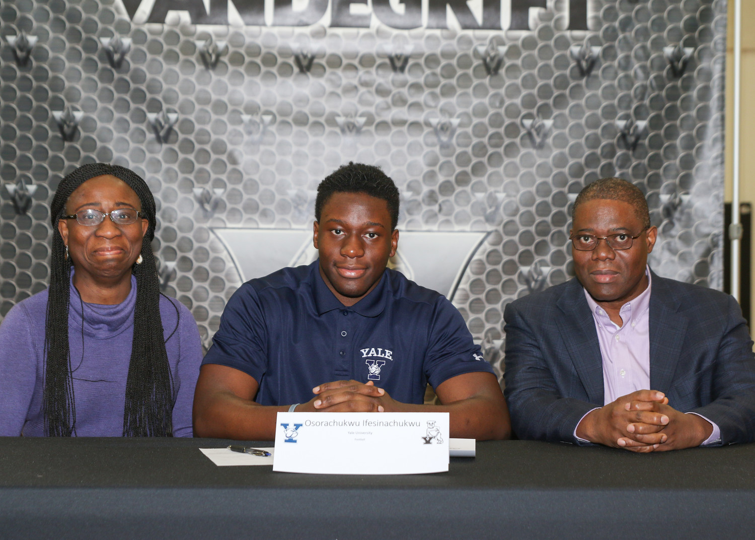 Osorachukwu Ifesinachukwu signed a letter of intent to play football at Yale University s during a signing day ceremony at Vandegrift High School on February 7, 2018.