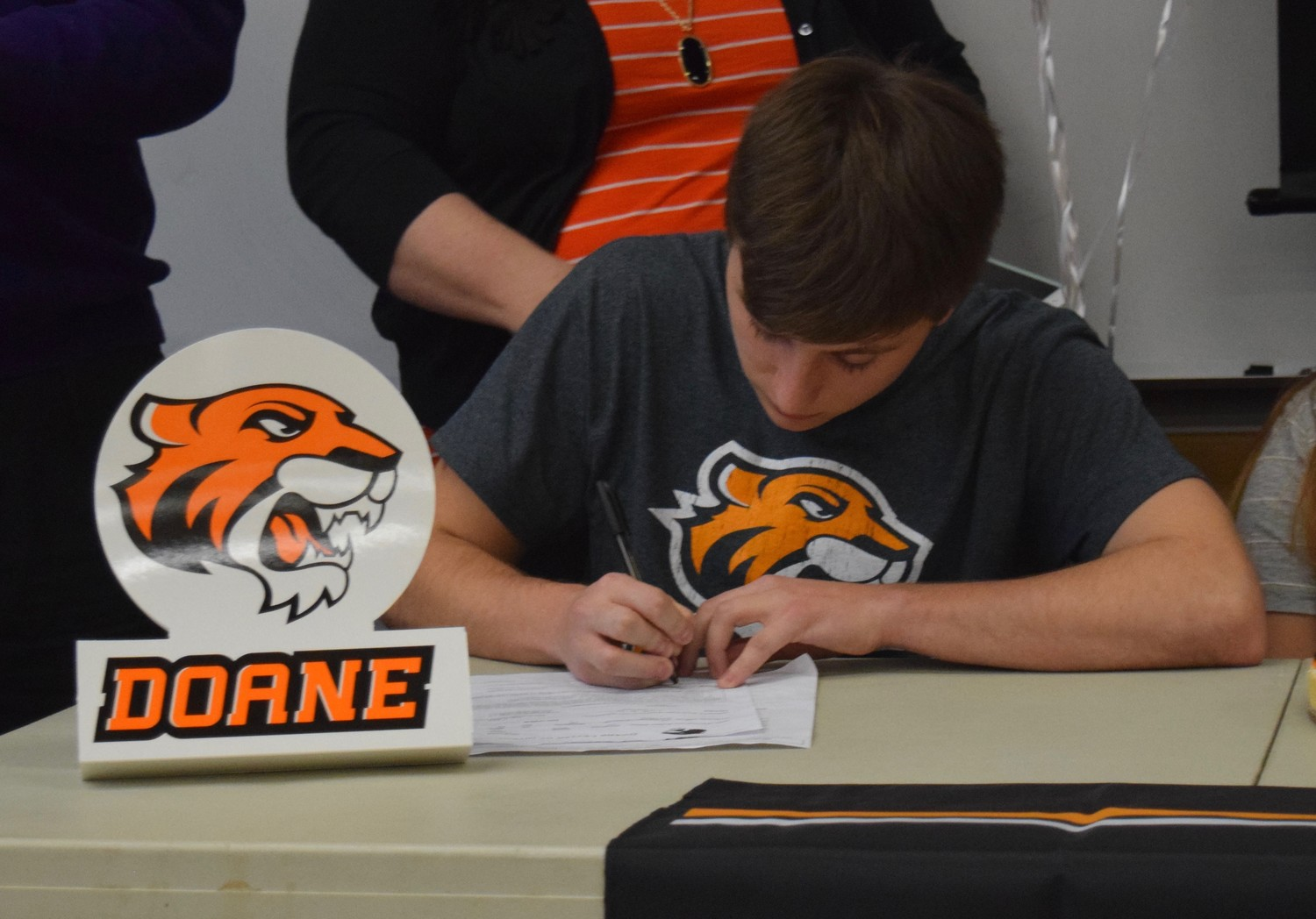 Rouse senior Trevor Provencher signed to play football at Doane University on Wednesday afternoon.
