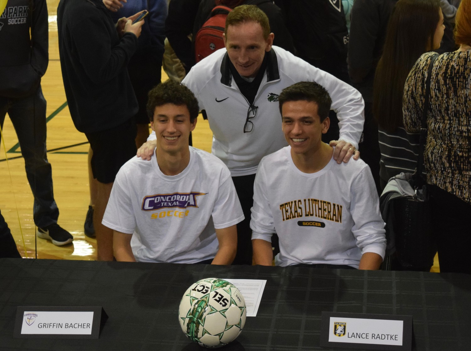 Soccer players Griffin Bacher (Concordia) and Lance Radtke (Texas Lutheran) with Cedar Park principle John Sloan at Signing Day on Wednesday morning.