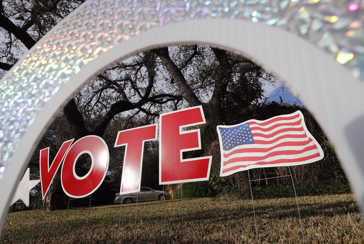"A ""vote"" sign in a yard in west Austin on Mar. 6, 2017."