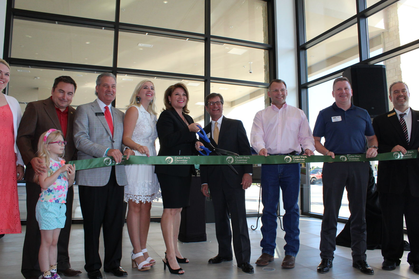 Toyota of Cedar Park and city officials line up for photos during the ribbon cutting ceremony of the grand opening of the car dealership in east Cedar Park, Tuesday, June 6.