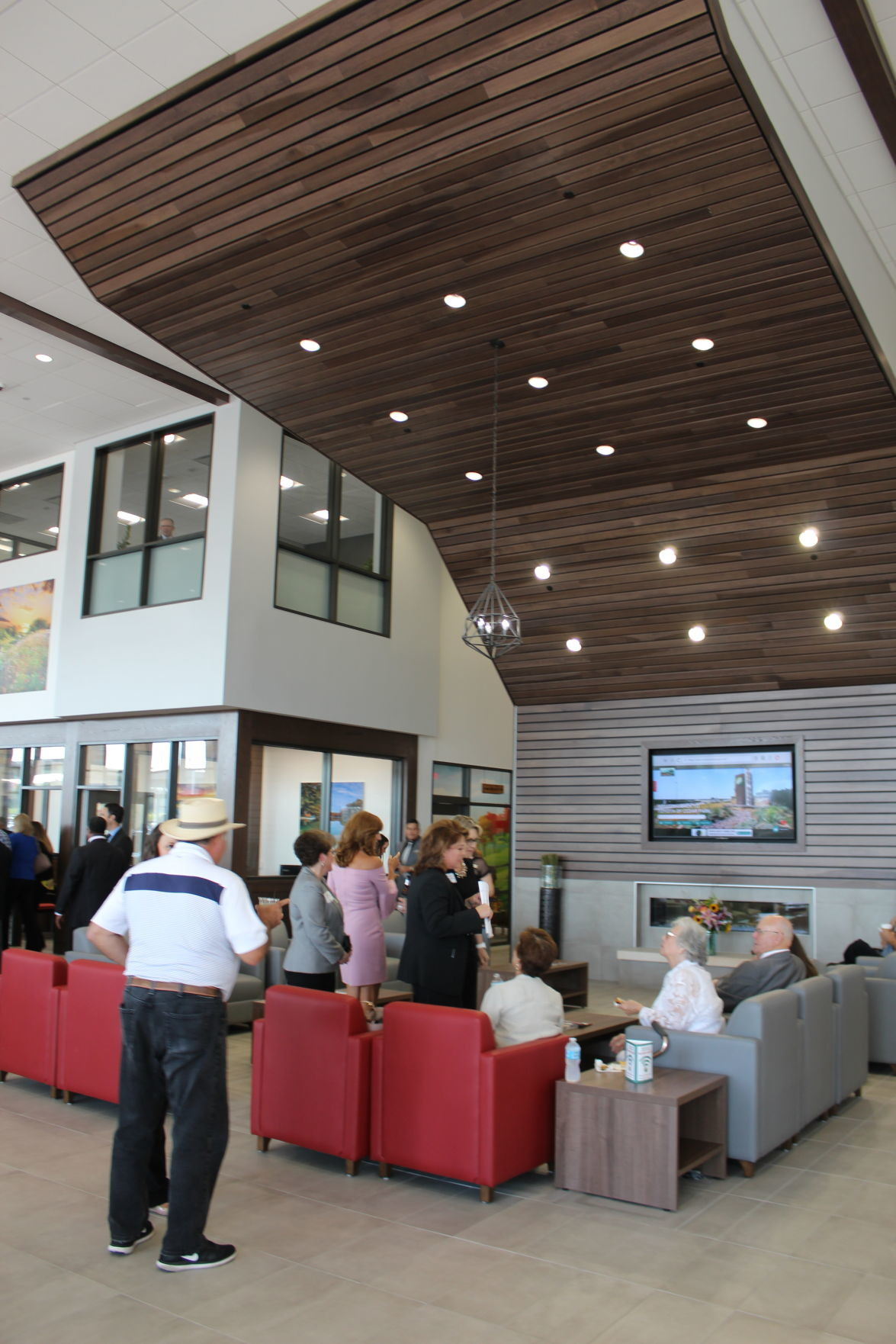 The cornerstone of the Toyota dealership's design is the rulan, a large, wood paneled half-arch that towers up into the ceiling of the customer lounge.