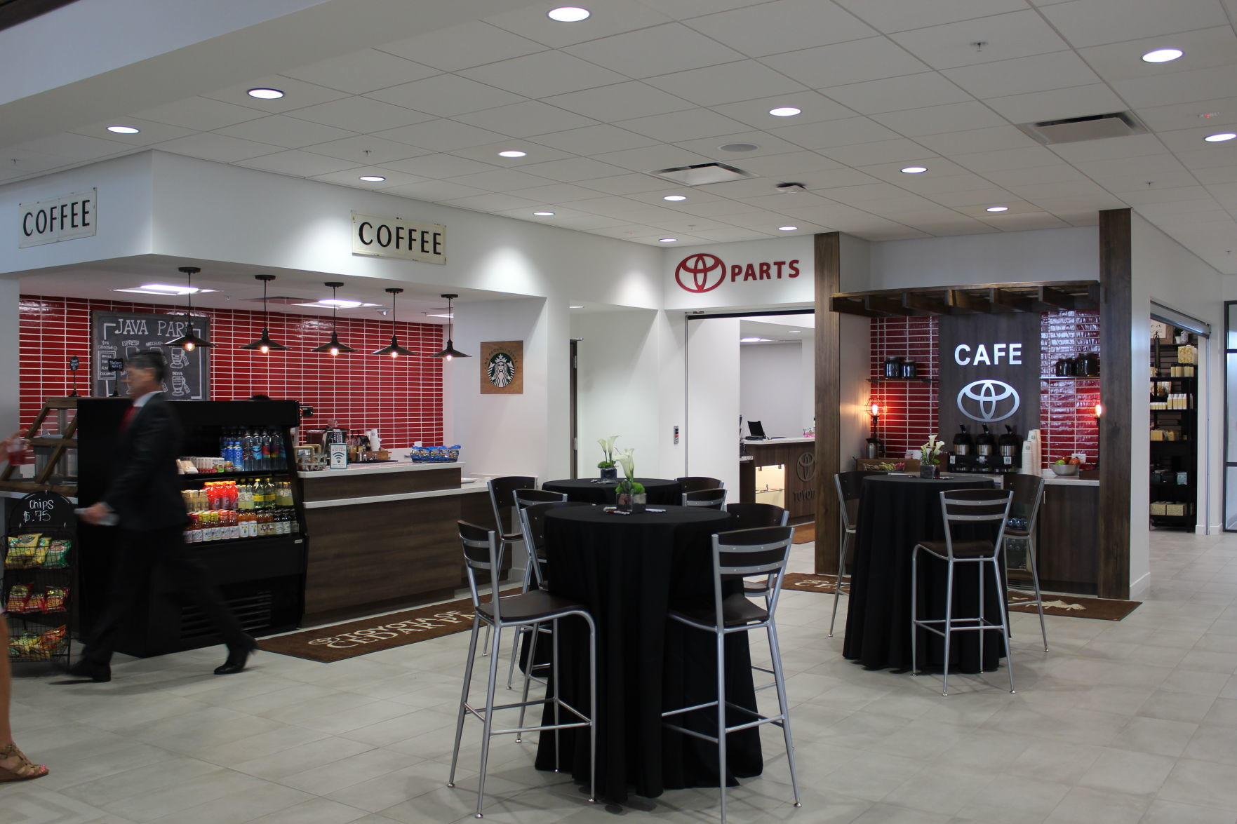 The 80,000 square-foot Toyota facility features a Starbucks cafe for customers waiting on service as well as a home decor boutique.