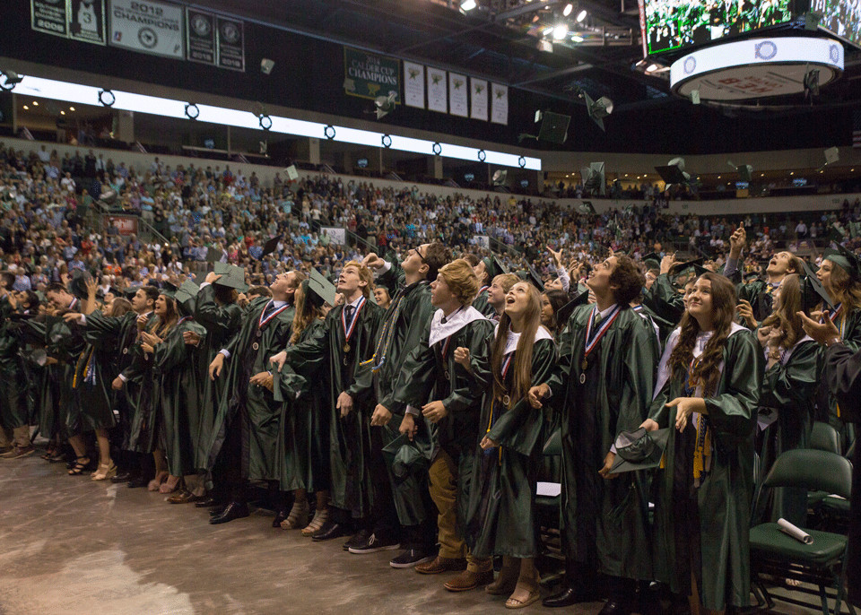 The Cedar Park High School graduating class of 2017 throws their caps into the air celebrating the end of their graduation ceremony at the HEB Center at Cedar Park Saturday, June 2.