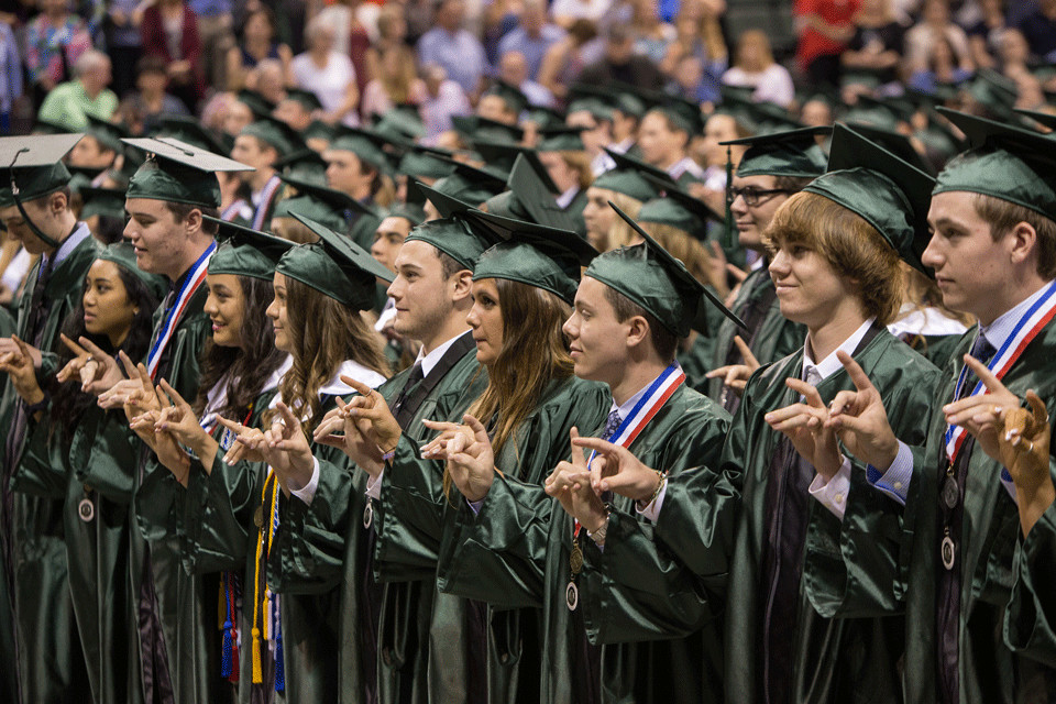 Students of the Cedar Park High School graduating class of 2017 make Timberwolf hand signals during their graduation ceremony at the HEB Center Saturday, June 2.