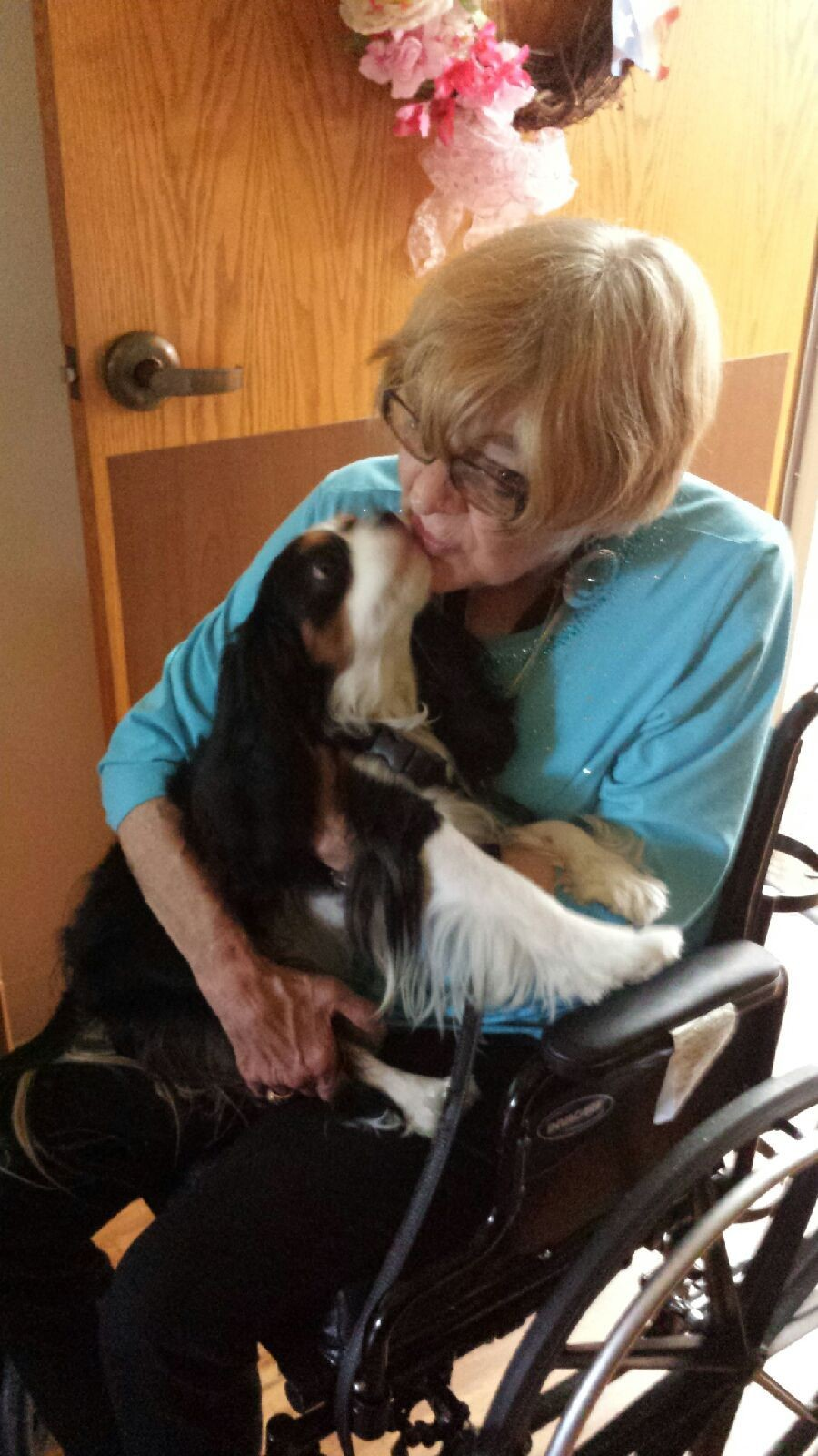 Ann, a retired veteran at William R. Courtney Texas State Veterans Home, joyously connects best with Chaucer, a trained therapy dog from Austin Dog Alliance.