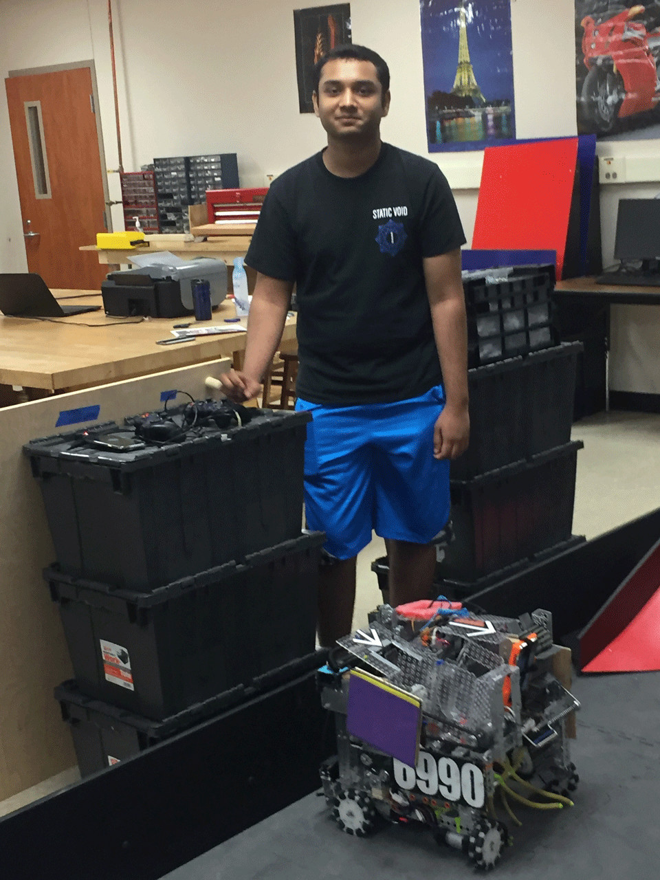 Photo by RICHARD LEGGITT/ Yash Chacharkar, 17, the assistant project manager for the Vista Ridge High School robotics team demonstrates the robot that helped the team win top honors at the University Interscholastic League state robotics championships.