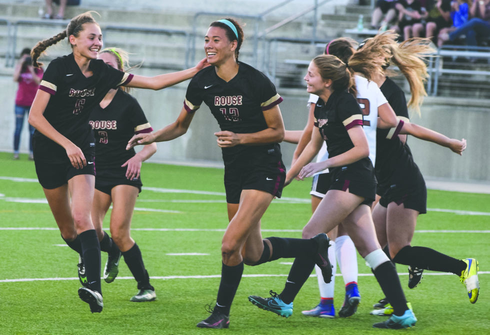 Teammates congratulate Rouse senior Haley Hoppe (center) during a playoff game earlier this season.