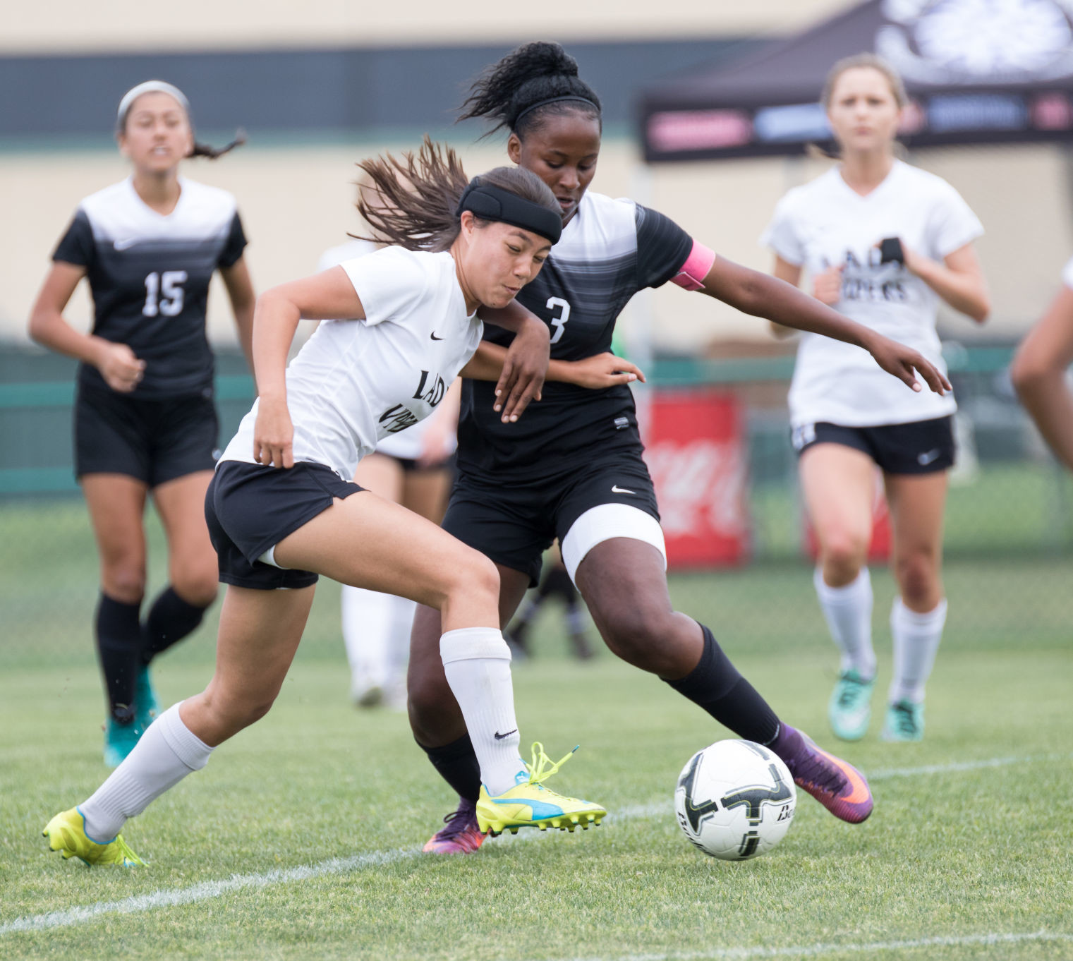 Vandegrift Vipers sophomore defender Brooke McArthur (1) battles Steele Knights senior forward Caleigha Callahan (3) for possession during a high school girls playoff soccer game between the Vandegrift Vipers and the Cibolo Steele Knights at the Blossom Athletic Center in San Antonio, Texas, on April 8, 2017. Vandegrift won 2-0.