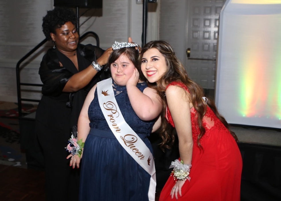 Leander High School Principal Tiffany Spicer (left) places a crown on Abby Cano. Keilany Solano (right) and Cano were ultimately both named LHS prom queens.