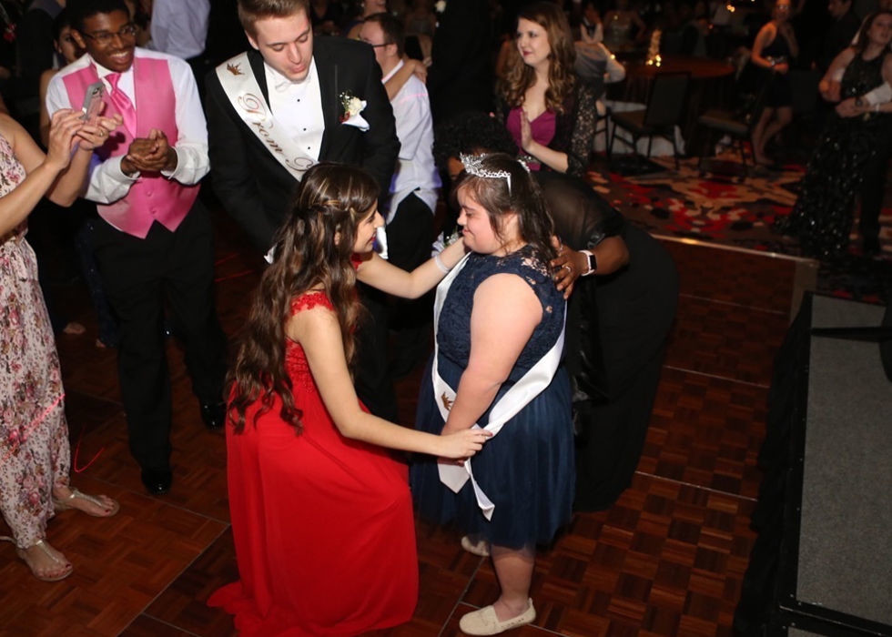Leander High School senior Keilany Solano (left) congratulates senior Abby Cano on prom night.