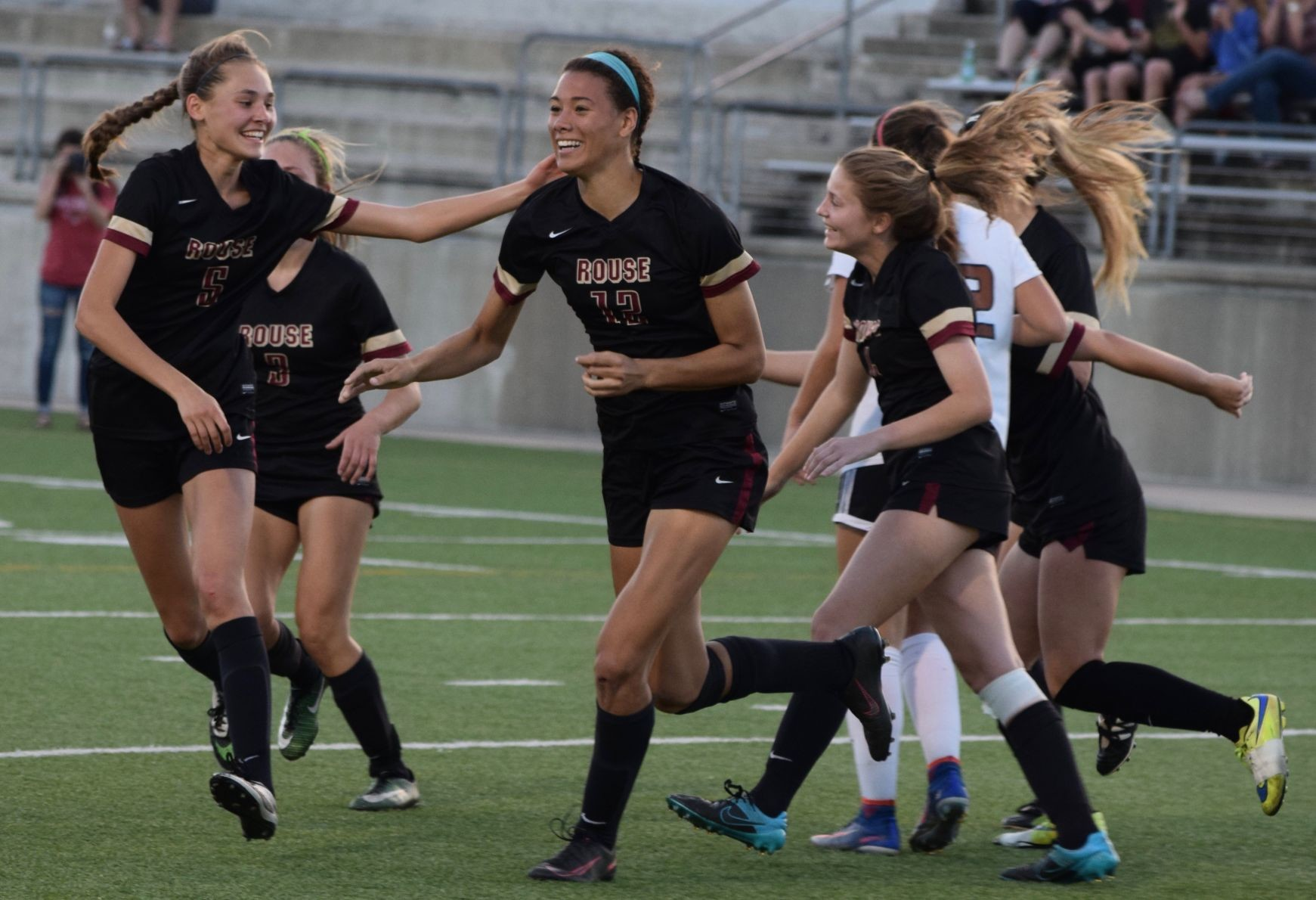 Haley Hoppe, center, scored two goals and the Rouse girls' soccer team beat Hutto 3-0 in the regional quarterfinals Tuesday night at Kelly Reeves Athletic Complex.