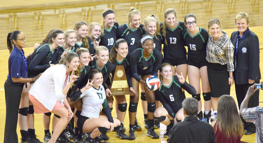 The Lady Timberwolves celebrate their UIL Regional Championship victory.