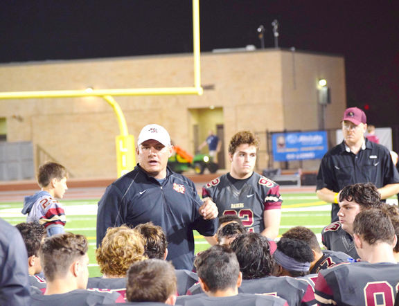 Rouse coach Josh Mann addresses his team in their season-ending win. Despite the win, Rouse missed the postseason.