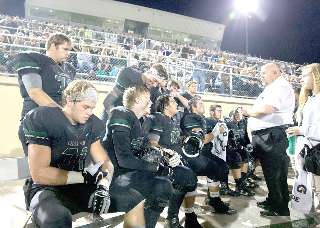 Cedar Park Timberwolves senior running back Tyler Lavine (left) and teammates listen to offensive line coach Beau Barksdale on the sidelines during a high school football game between the Cedar Park Timberwolves and the Connally Cougars at John Gupton Stadium in Cedar Park, Texas on October 21, 2016. Cedar Park won 49-0.