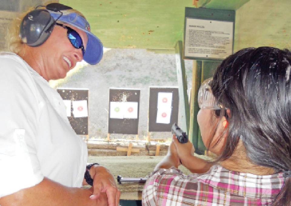 Austin-based instructor and A Girl and A Gun co-founder Renee Blaine teaches first-time shooter Nicole B. the basics on gun handling, targeting, aiming and safety at Eagle Peak Shooting Range in Leander