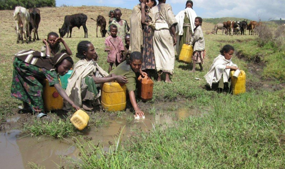Dick Moeller, a River Place businessman, founded W2T a couple of years ago and to date the organization has brought clean water to more than 90,000 people in Africa. Women and children collect water from a contaminated water source.
