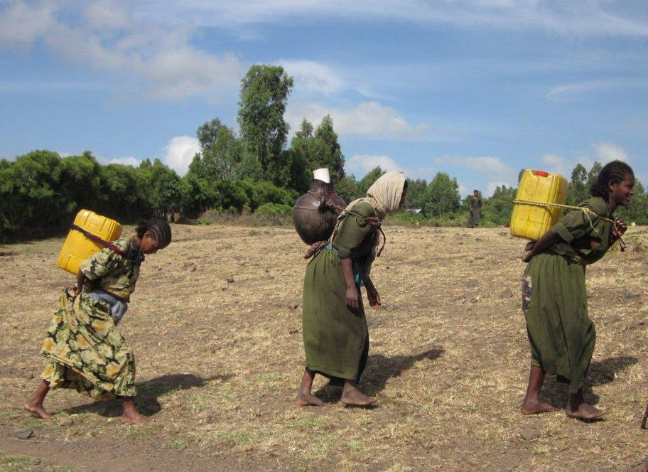 Three women haul water from Seha water point.