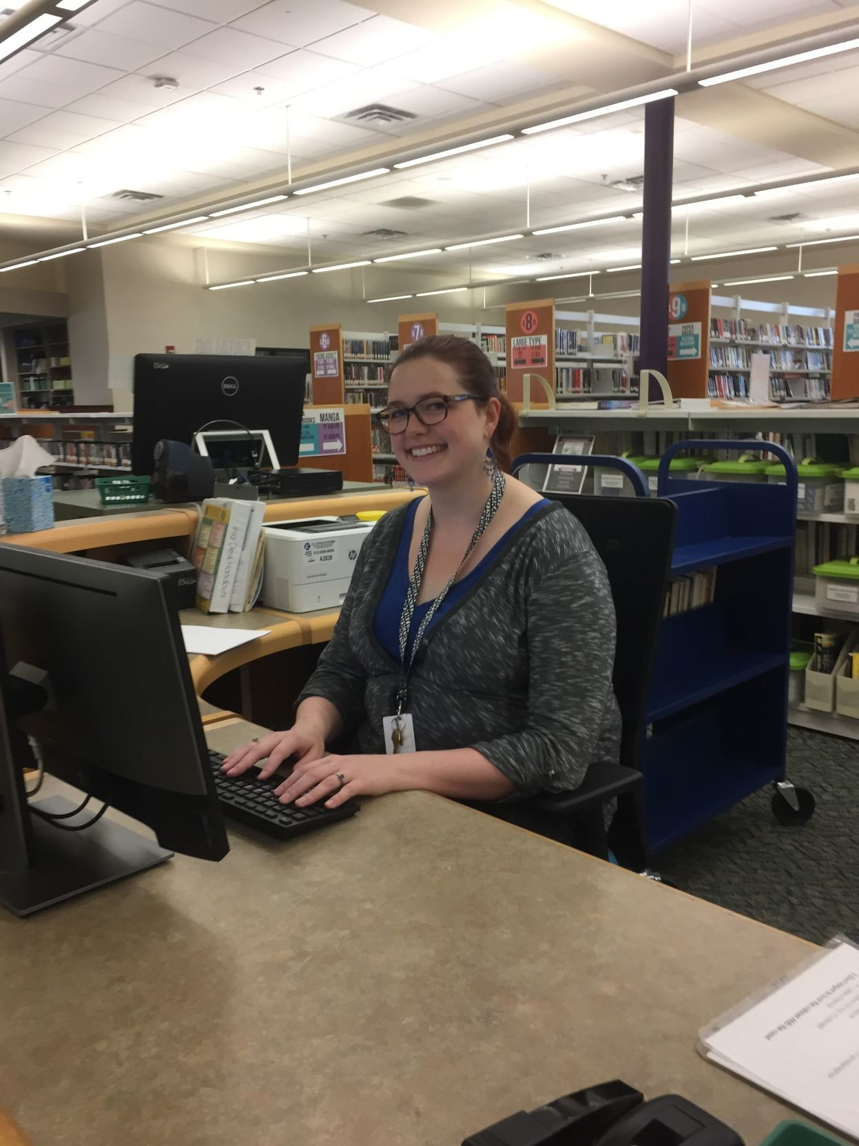 Marjory Gibson, a library assistant, cheerfully helps patrons at the Cedar Park Library, the go-to hotspot for area residents. The library features everything from knitting classes, to veterans activities, to reading and music programs for infants, toddlers and pre-schoolers.