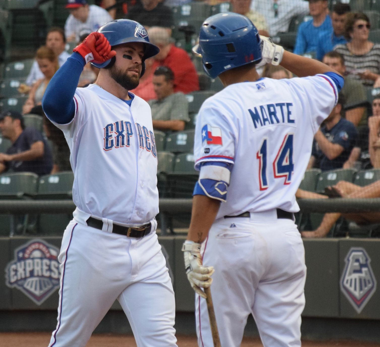 Jason Martinson, left, hit a three-run home run, one of three long balls by Round Rock in its 10-1 win over the New Orleans Baby Cakes Monday night at Dell Diamond.