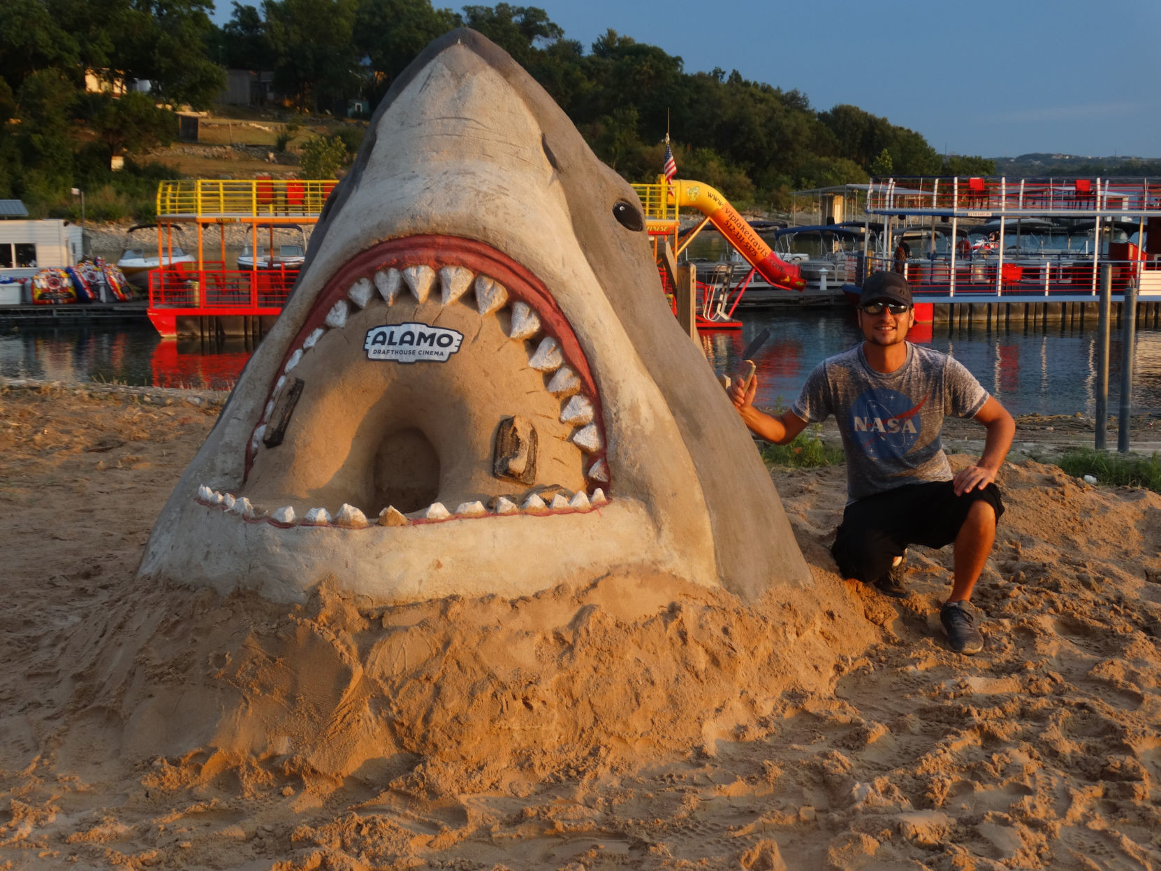 Joaquin Cortez, next to his JAWS sand sculpture.
