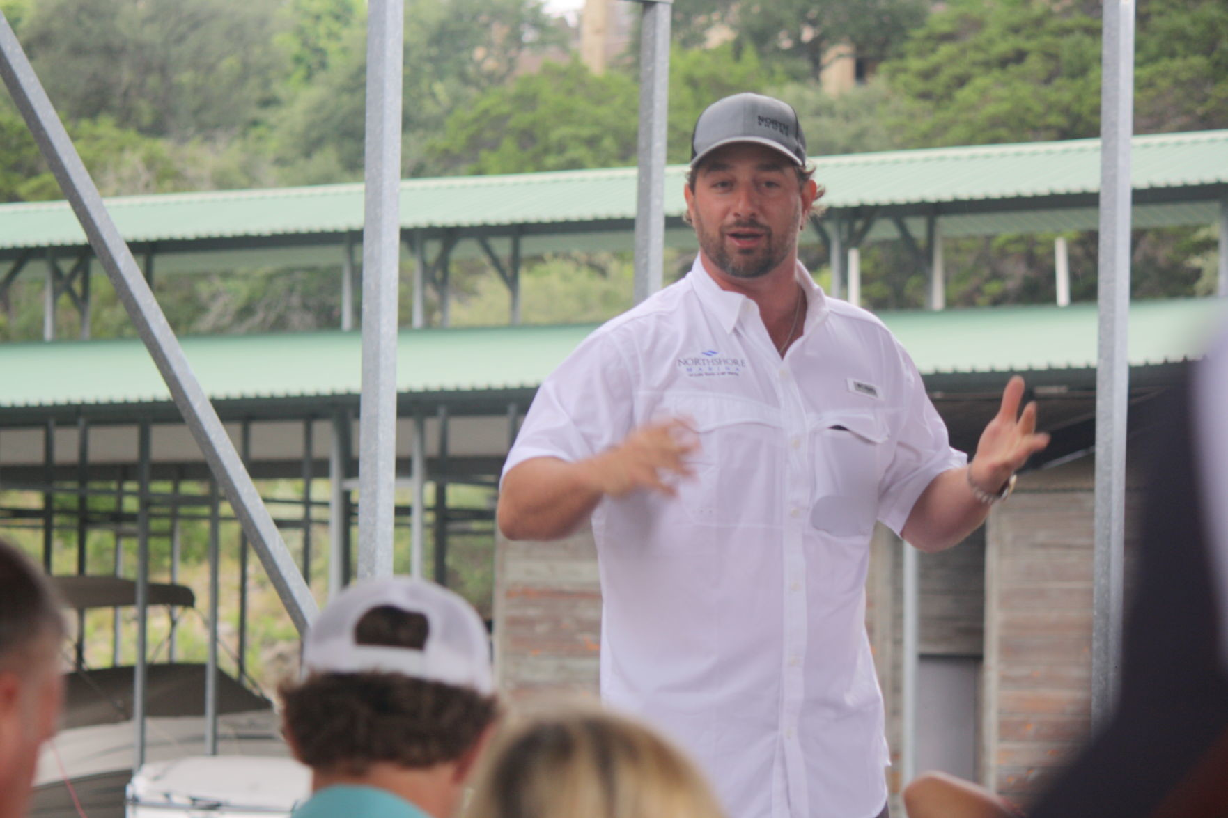 Austin Cameron speaks at the ribbon cutting for NorthShore Marina's addition of 71 new boat slips, Saturday, June 24.