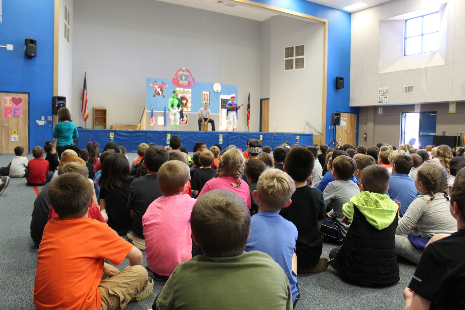 Students at Ada Mae Faubion Elementary School watch as the Cedar Park Fire Dept. HEATS team perform a sketch about fire safety, Tuesday, Oct. 17.