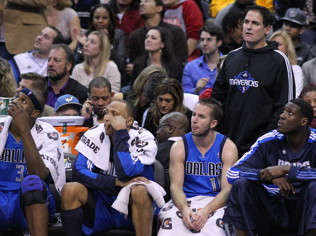 Dallas Mavericks owner Mark Cuban down near the bench during a game. Cuban and the Mavericks return 20-year veteran Dirk Nowitzki this season, but the franchise's new potential star player will need time to grow.
