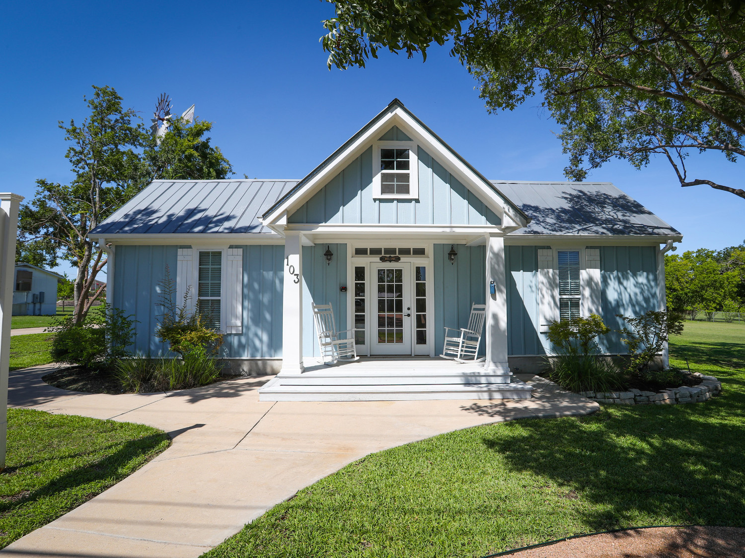 The architectural style of CMP Management at 103 N. West Drive in Leander highlights the historical architectural patterns and principles that may be included in the city's architectural pattern book for residential home development.